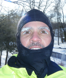 man in balaclava with ice on eyebrows